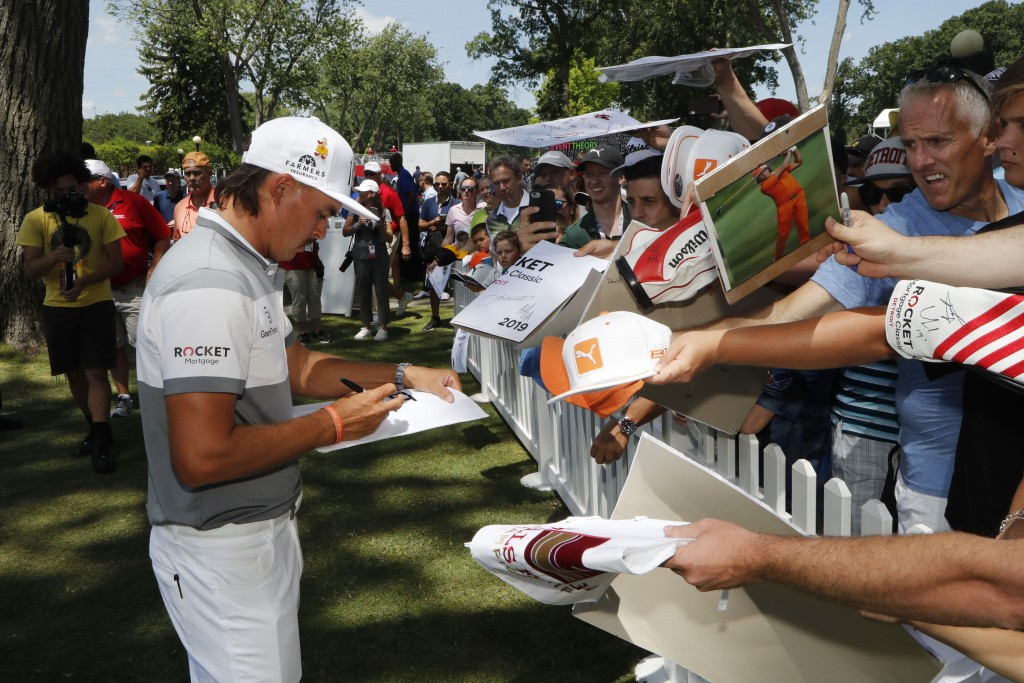 Rickie Fowler signs autographs during the Pro-Am for the Rocket Mortgage Classic golf tournament, Wednesday, June 26, 2019, in Detroit. (AP Photo/Carl...