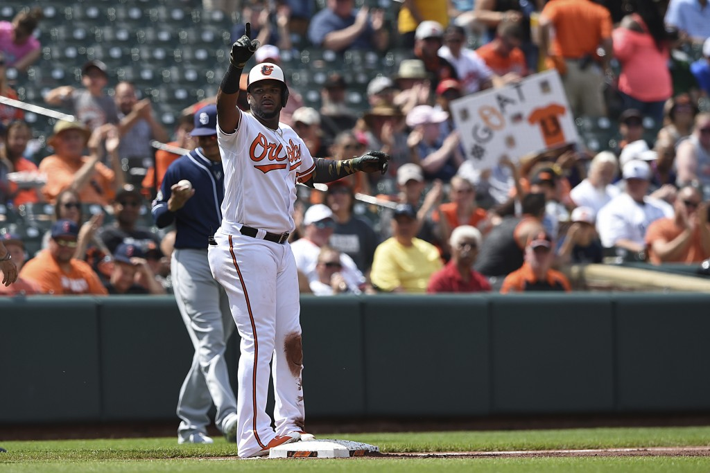 Baltimore Orioles' Hanser Alberto reacts after hitting a triple against the San Diego Padres in the first inning of a baseball game Wednesday, June 26...