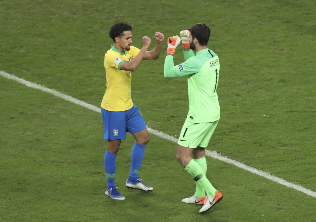 Brazil's Marquinho, left, and his goalkeeper Alison celebrate during a penalty shoot-out against Paraguay at a Copa America quarterfinal soccer match ...