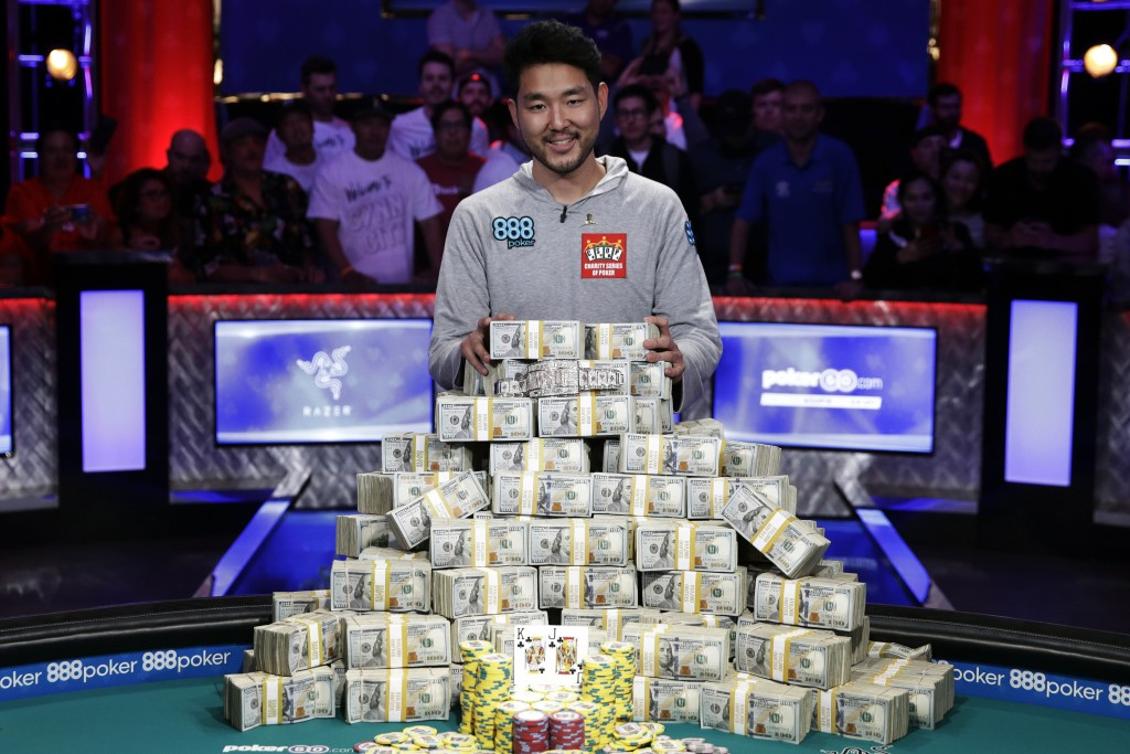 FILE - In this July 15, 2018, file photo, John Cynn poses after winning the World Series of Poker main event in Las Vegas. Tens of thousands of profes...