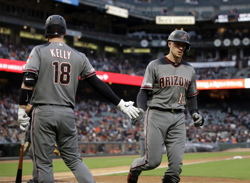 Arizona Diamondbacks' Nick Ahmed, right, is congratulated by Carson Kelly after hitting a home run off San Francisco Giants' Tyler Beede during the fi...