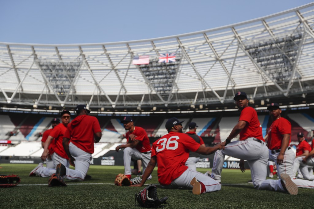 Members of the Boston Red Sox warm up before batting practice in London, Friday, June 28, 2019. Major League Baseball will make its European debut wit...