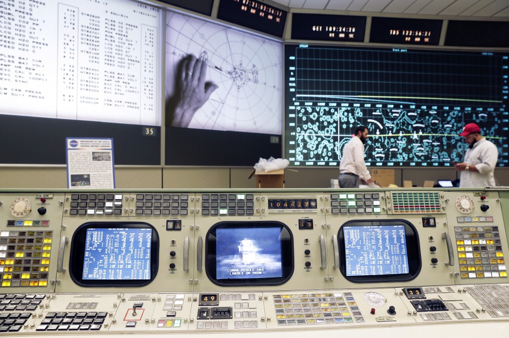 """The console for Booster Systems Engineer, the first position on the first row known as """"The Trench,"""" has an overview of the Display and Projection scr..."""