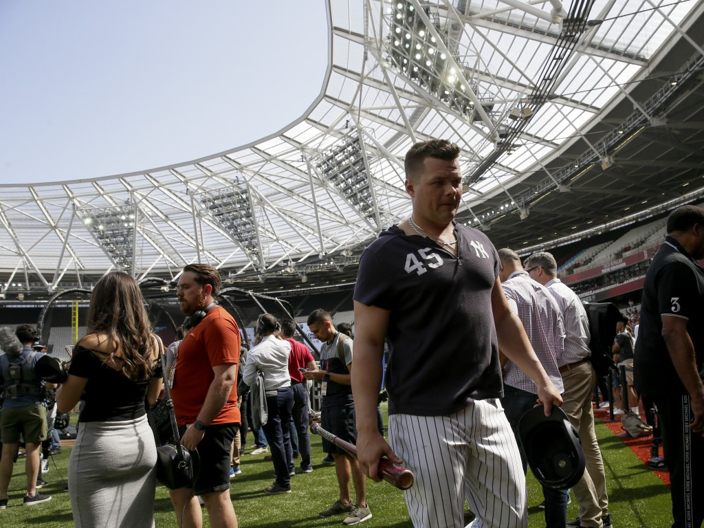 New York Yankees first baseman Luke Voit walks off the field after batting practice in London, Friday, June 28, 2019. Major League Baseball will make ...
