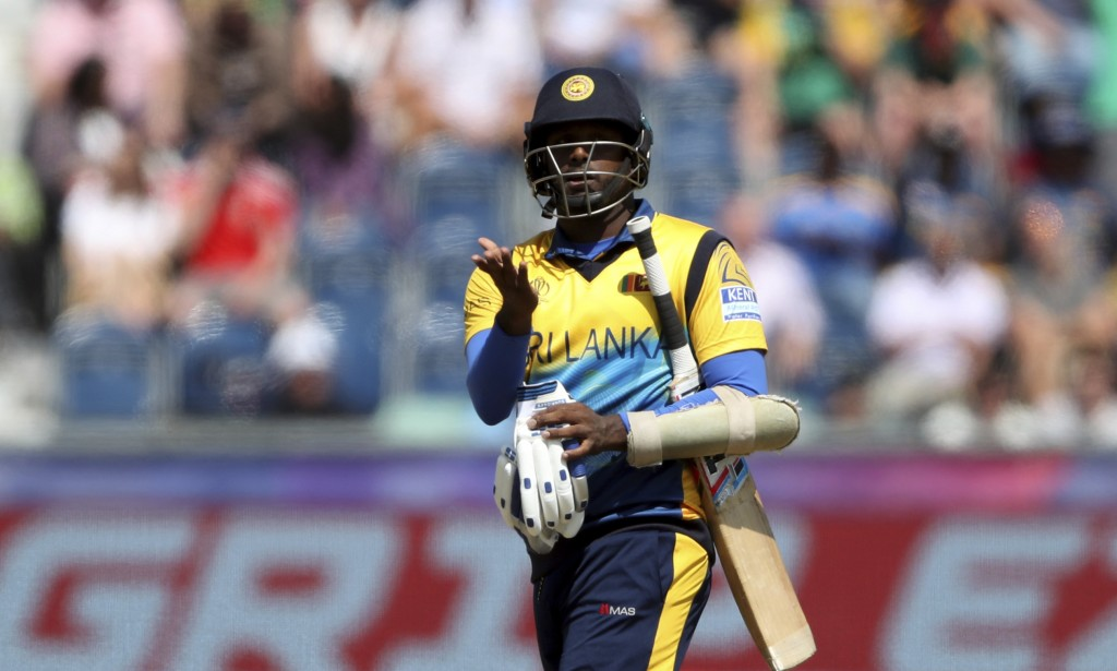 Sri Lanka's batsman Angelo Mathews reacts as he leaves the crease after being bowled by South Africa's bowler Chris Morris for 30 runs during the Cric...
