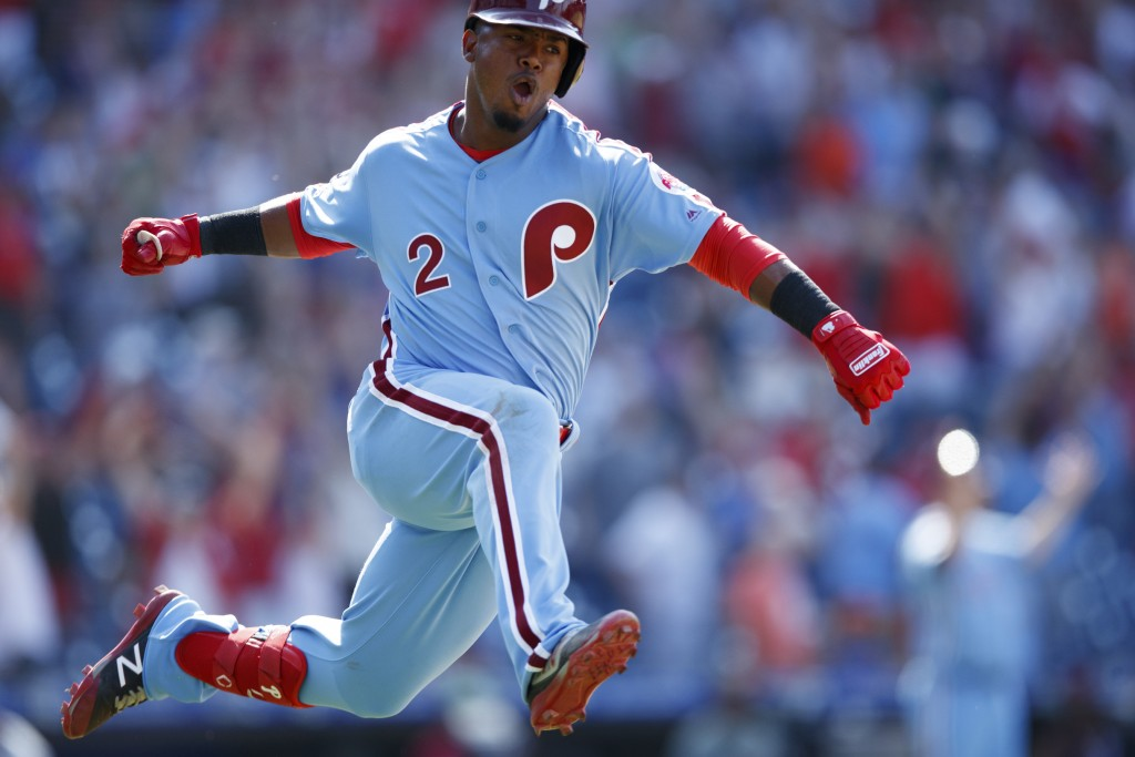 Philadelphia Phillies' Jean Segura celebrates after hitting a game-winning three-run home run off New York Mets relief pitcher Edwin Diaz during the n...