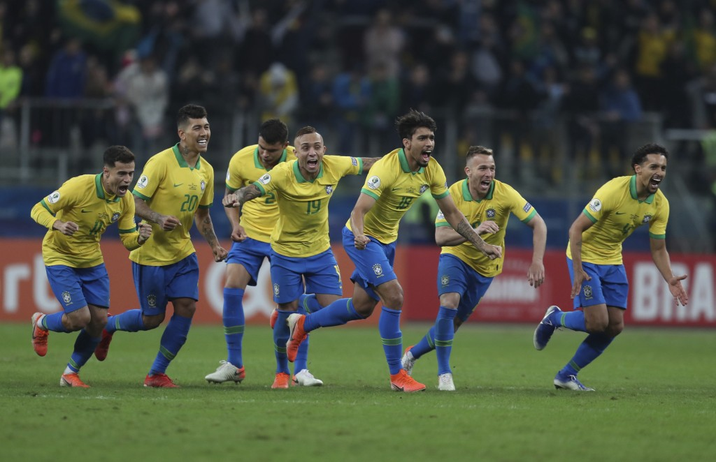 Brazil's soccer players celebrate winning at the end of the Copa America quarterfinal soccer match against Paraguay at the Arena do Gremio in Porto Al...