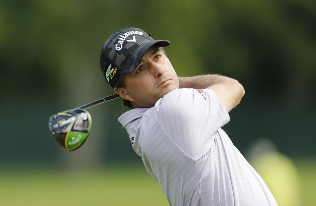 Kevin Kisner drives off the fifth tee during the first round of the Rocket Mortgage Classic golf tournament, Thursday, June 27, 2019, in Detroit. (AP ...