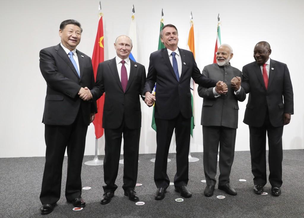 From left: China's President Xi Jinping, Russian President Vladimir Putin, Brazilian President Jair Bolsonaro, Indian Prime Minister Narendra Modi, an...