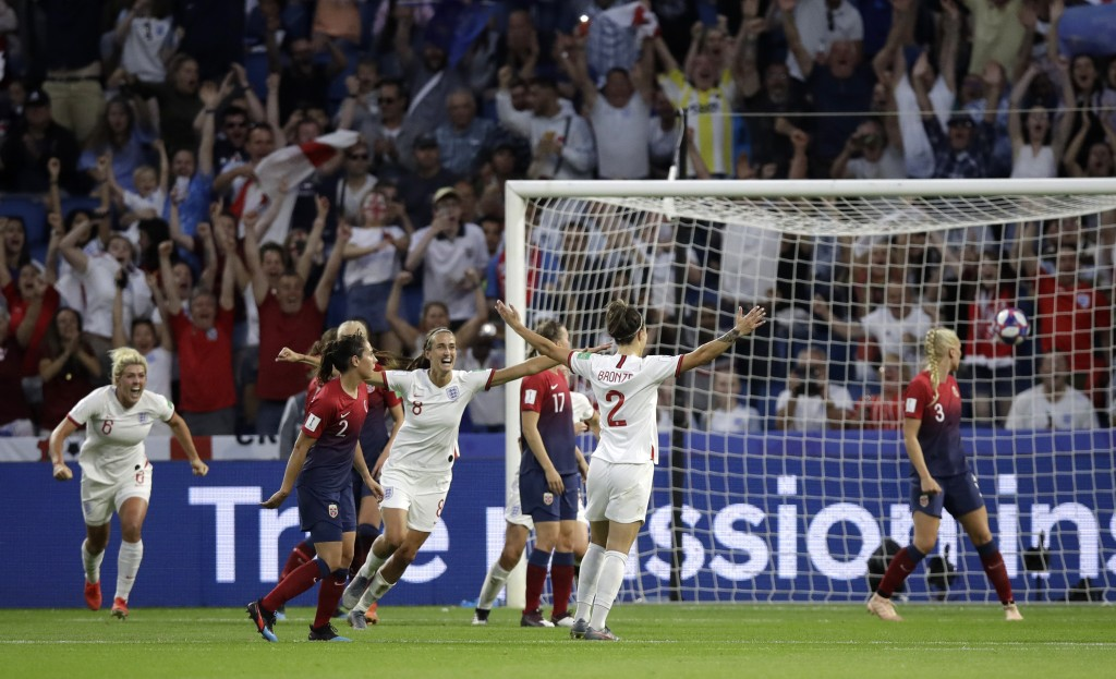 England's Lucy Bronze, second right, reacts after scoring her team's third goal during the Women's World Cup quarterfinal soccer match between Norway ...