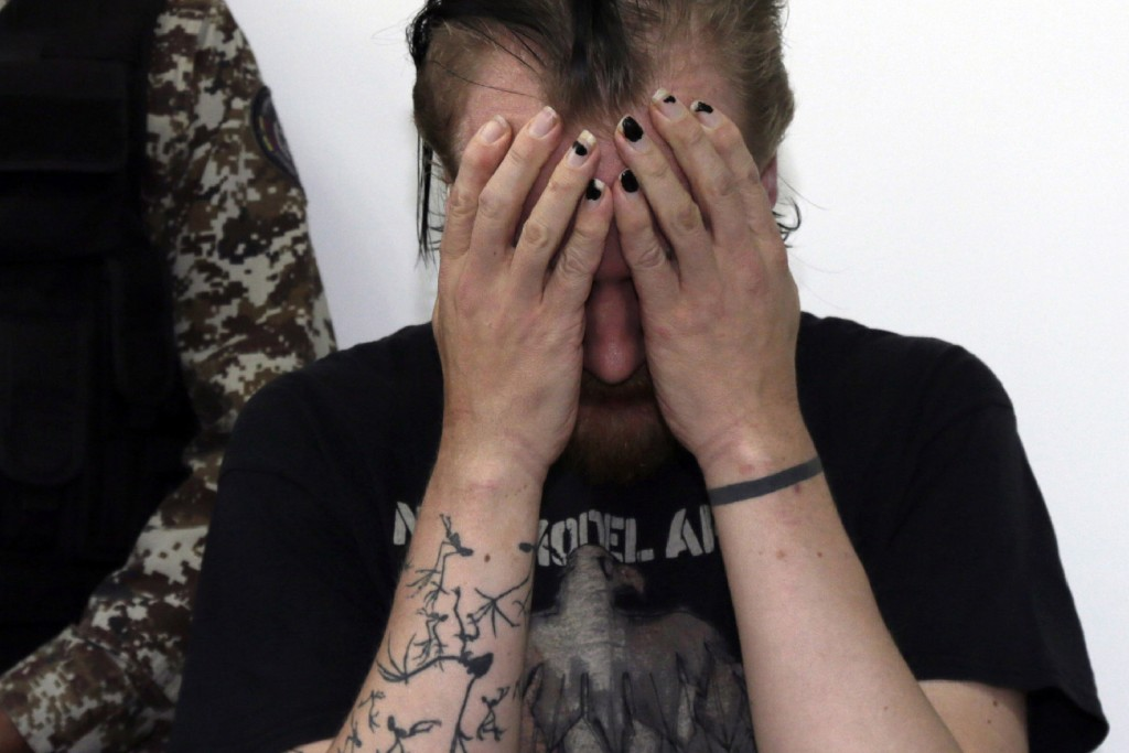 Swedish programmer Ola Bini places his hands over his face during his Habeas Corpus hearing in Quito, Ecuador, Thursday, June 20, 2019. The Swedish pr...