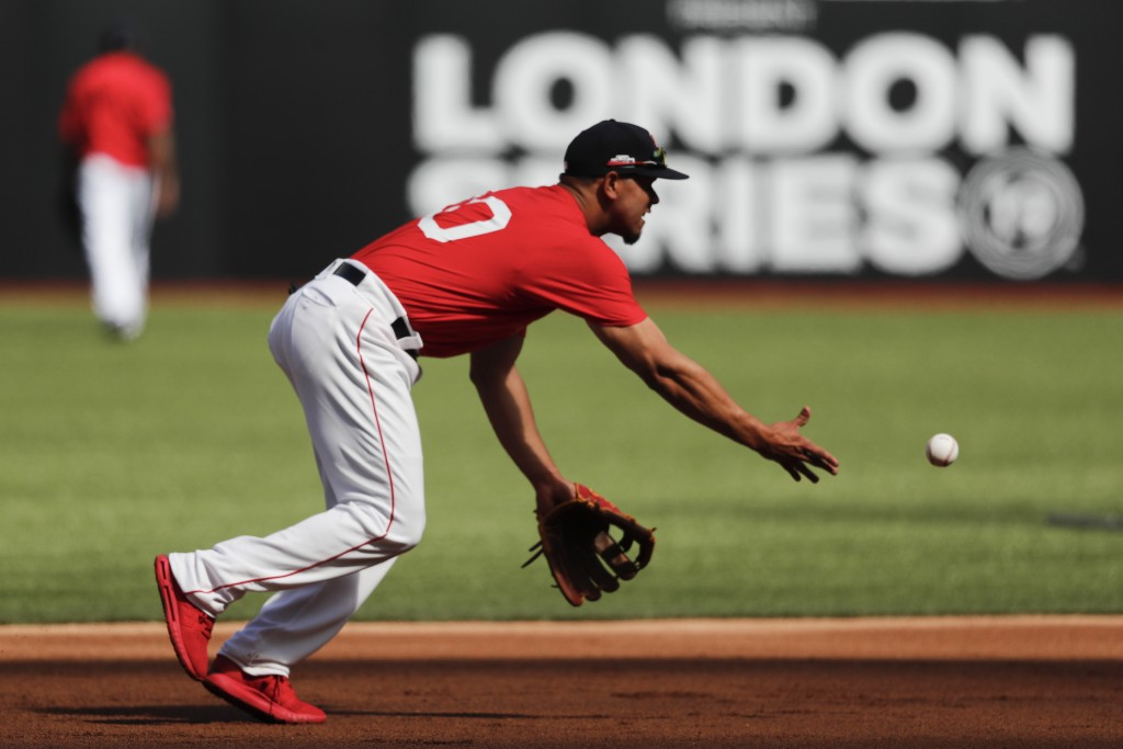 Boston Red Sox third baseman Marco Hernandez fields a ball during batting practice in London, Friday, June 28, 2019. Major League Baseball will make i...