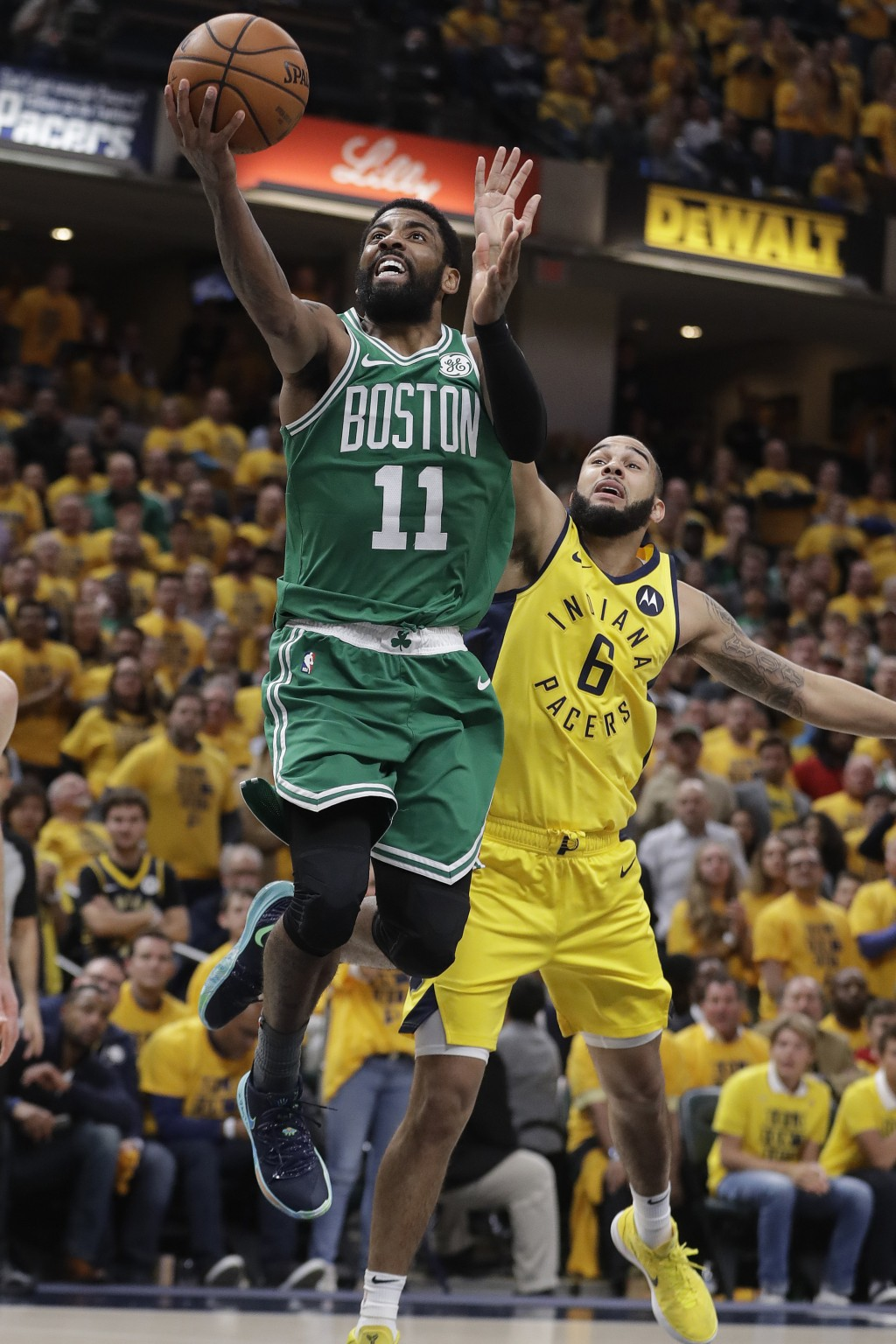 FILE - In this April 19, 2019, file photo, Boston Celtics' Kyrie Irving (11) shoots against Indiana Pacers' Cory Joseph (6) during the second half of ...