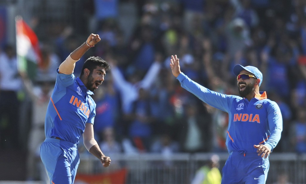 India's Jasprit Bumrah, left, celebrates with captain Virat Kohli after dismissing West Indies' Fabian Allen during the Cricket World Cup match betwee...
