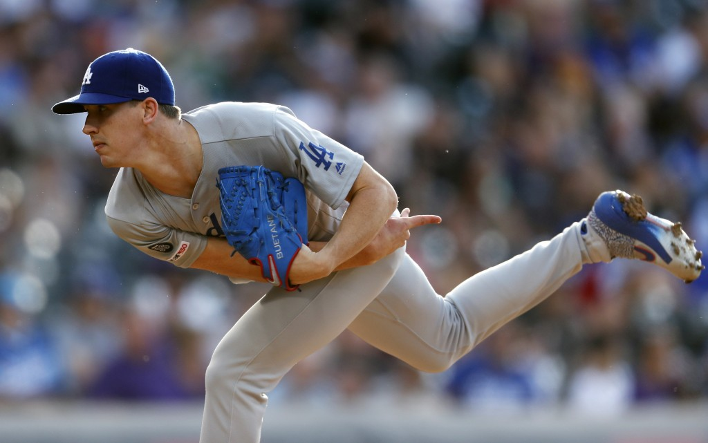Los Angeles Dodgers starting pitcher Walker Buehler works against the Colorado Rockies during the first inning of a baseball game Thursday, June 27, 2...