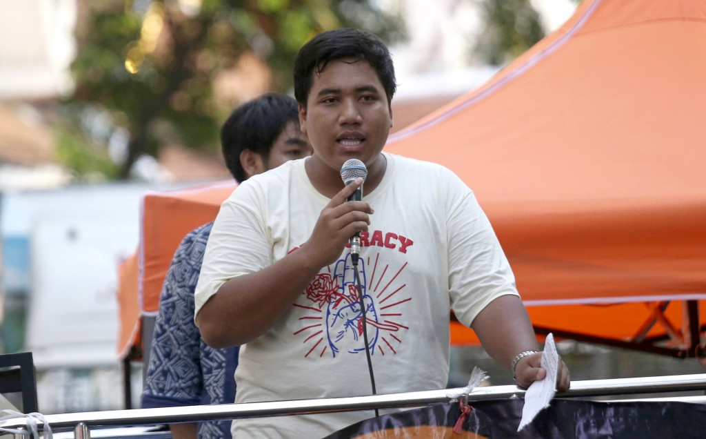 FILE - In this May 22, 2018, file photo, a pro-democracy leader Sirawith Seritiwat talks on the micro phone during a gathering marking the fourth anni...