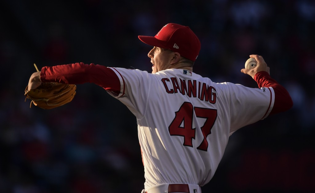 Los Angeles Angels starting pitcher Griffin Canning throws during the first inning of the team's baseball game against the Oakland Athletics on Thursd...