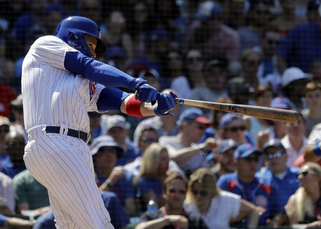 Chicago Cubs' Victor Caratini hits a two-run home run against the Atlanta Braves during the fifth inning of a baseball game in Chicago, Thursday, June...