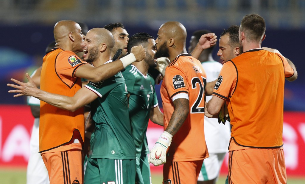 Algerian players celebrate after the African Cup of Nations group C soccer match between Algeria and Senegal at 30 June Stadium in Cairo, Egypt, Thurs...