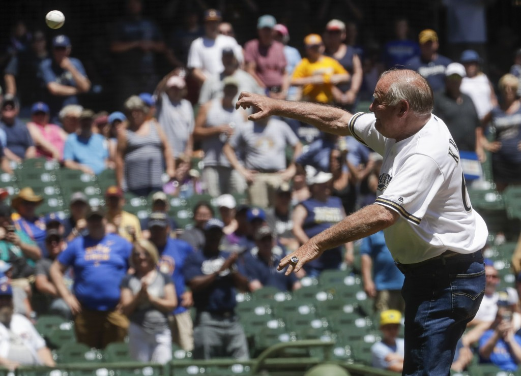Former Green Bay Packers Jerry Kramer throws a ceremonial first pitch before a baseball game between the Milwaukee Brewers and the Seattle Mariners Th...