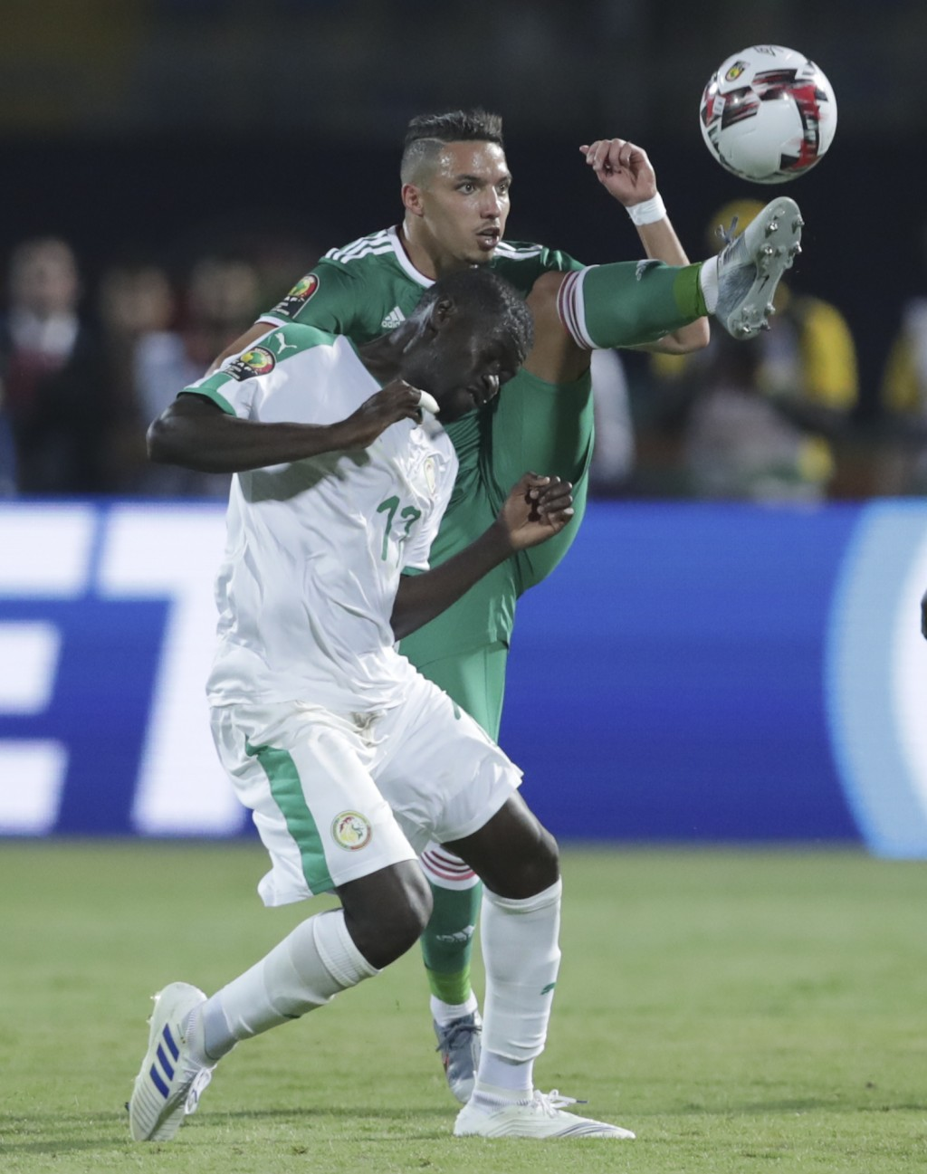 Senegal's Papa Alioune Ndiaye, left, and Algeria's Ismael Bennacer fight for the ball during the African Cup of Nations group C soccer match between A...