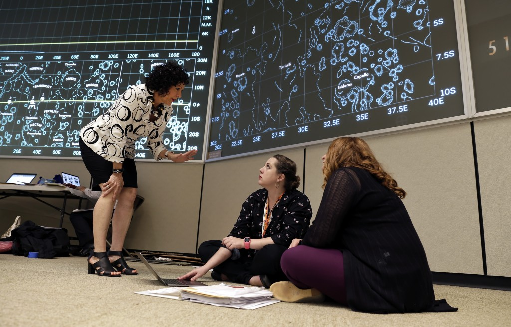 Historic Preservation Officer Sandra Tetley, left, talks with Delaney Harris-Finch, center, with Stern and Bucek Architects and Sonya Yungeberg, right...