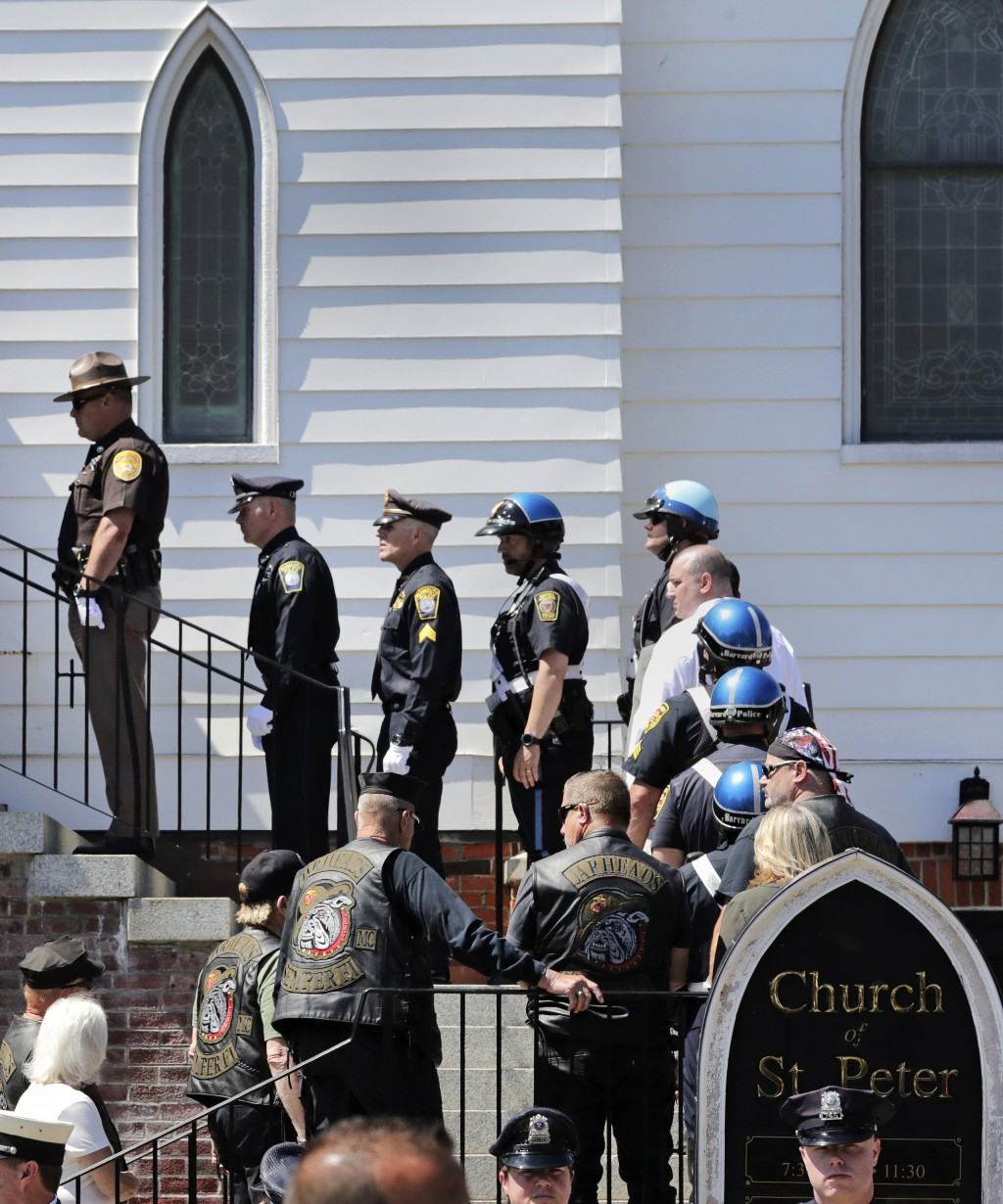 Police officers and members of the Jarheads Motorcycle Club wait in line for the funeral of Michael Ferazzi at St. Peter's Catholic Church in Plymouth...