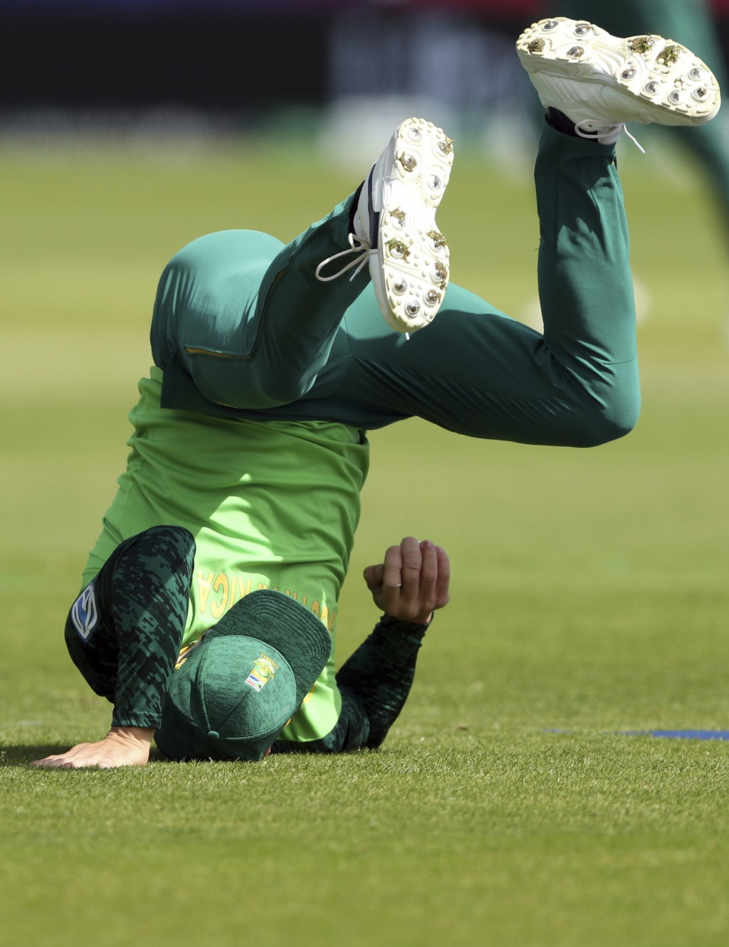 South Africa's captain Faf du Plessis falls on the ground after taking a catch to dismiss Sri Lanka's batsman Avishka Fernando for 30 runs during the ...