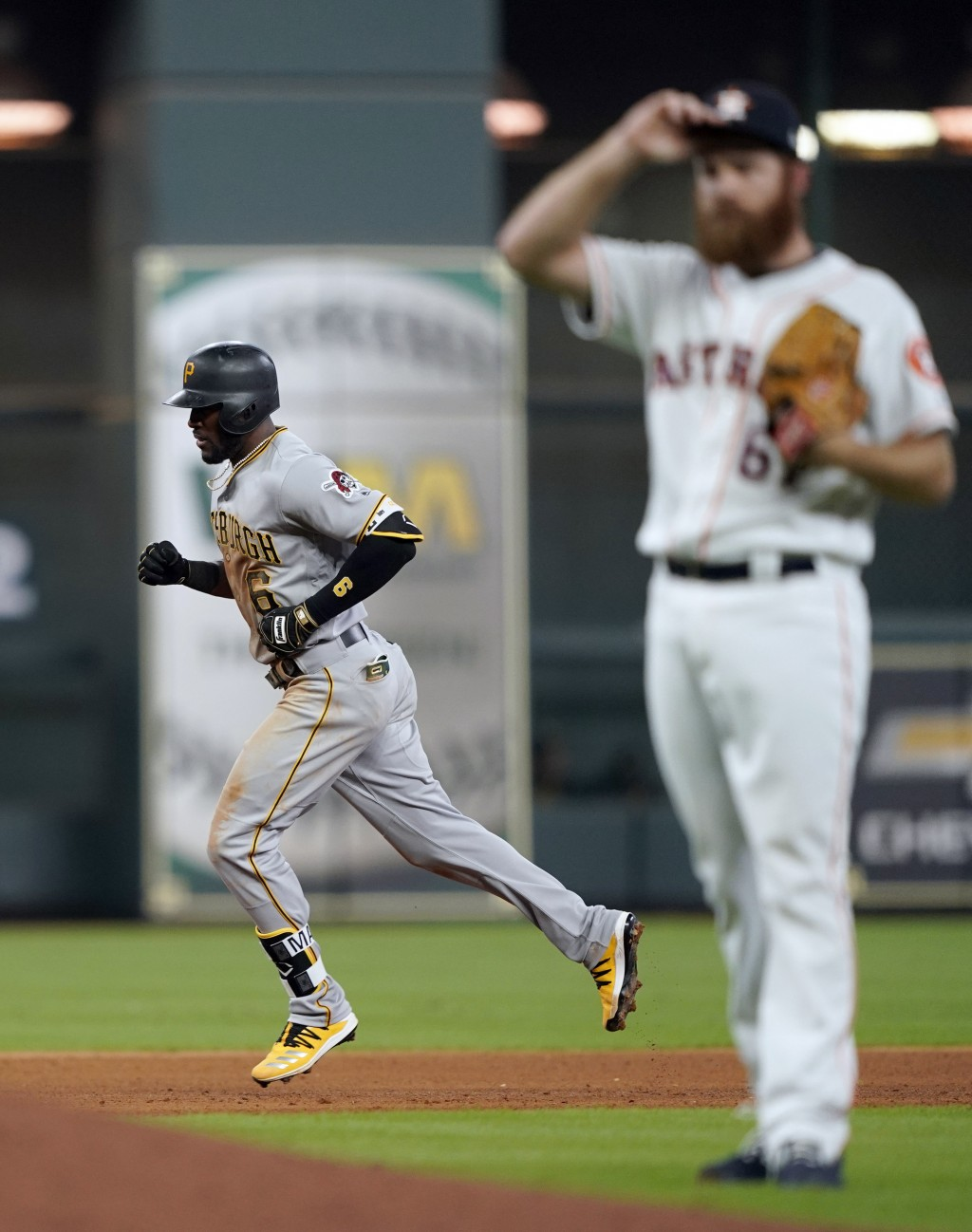 Pittsburgh Pirates' Starling Marte (6) runs the bases after hitting a home run off Houston Astros pitcher Cy Sneed, right, during the fifth inning of ...