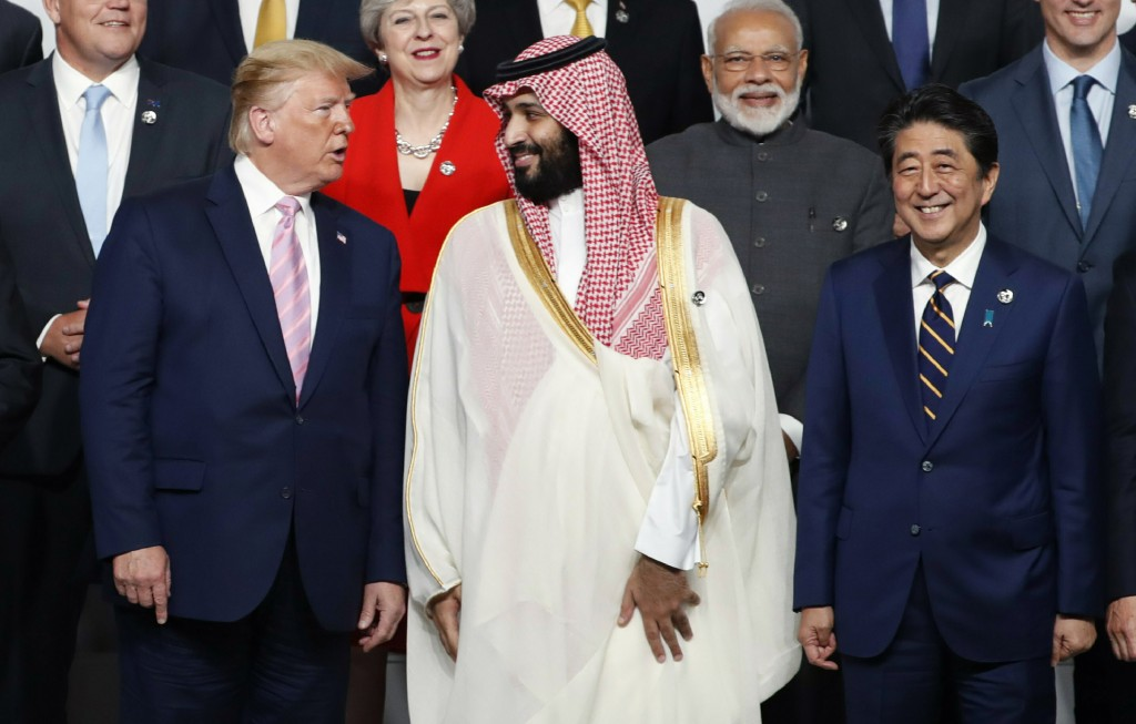 U.S. President Donald Trump, left, speaks with Saudi Arabia's Crown Prince Mohammed bin Salman during family photo session at G-20 leaders summit in O...