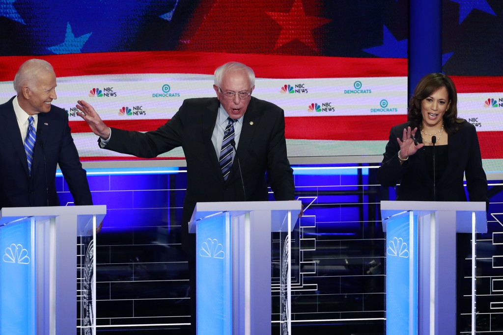 Democratic presidential candidate Sen. Bernie Sanders, I-Vt., , center, gestures towards former vice president Joe Biden, as Sen. Kamala Harris, D-Cal