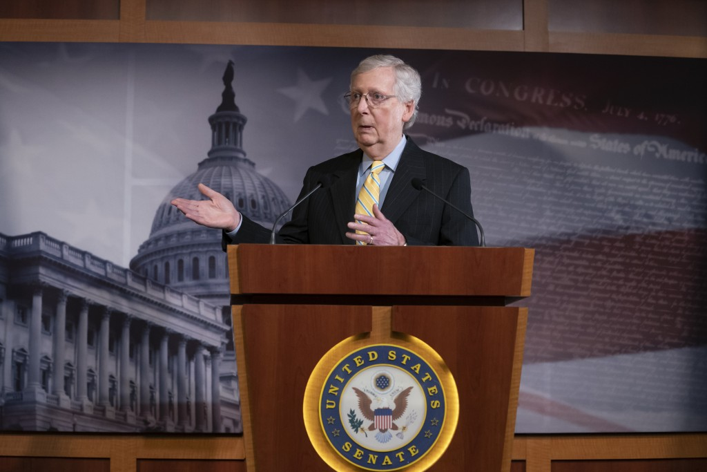 Senate Majority Leader Mitch McConnell, R-Ky., holds a news conference ahead of the Fourth of July break, at the Capitol in Washington, Thursday, June...