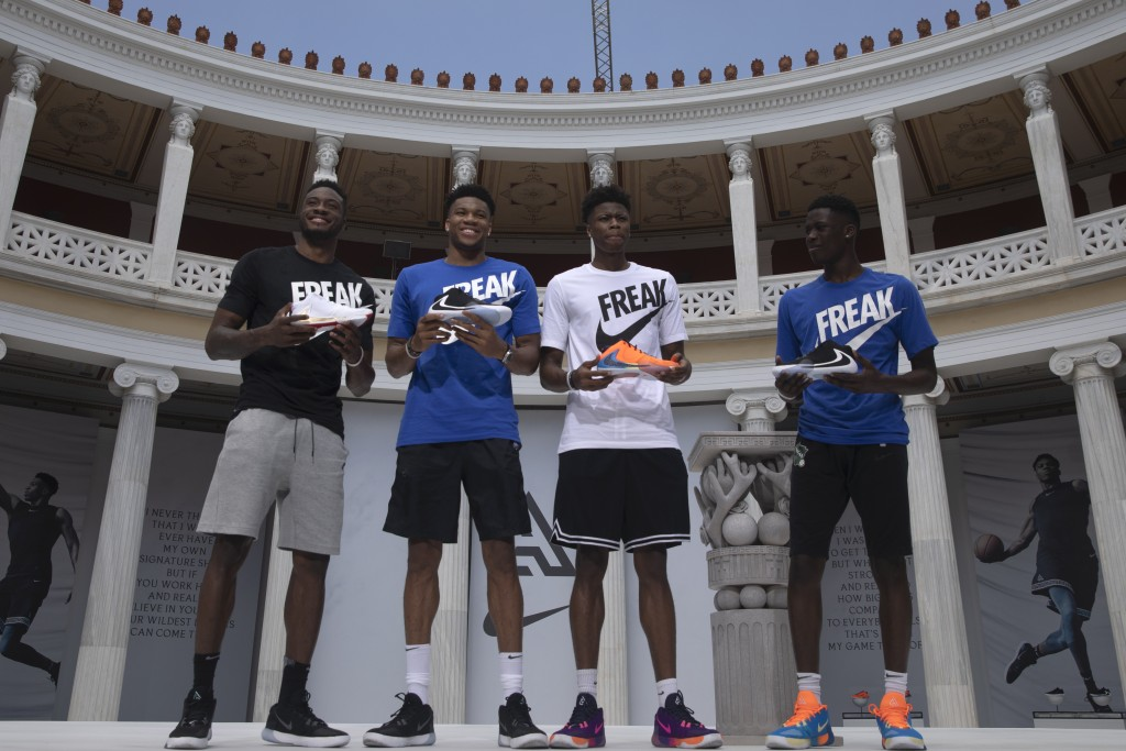 Basketball player Giannis Antetokounmpo, second left, of the Milwaukee Bucks, who was named NBA Most Valuable Player for the 2018-19 poses with his br...