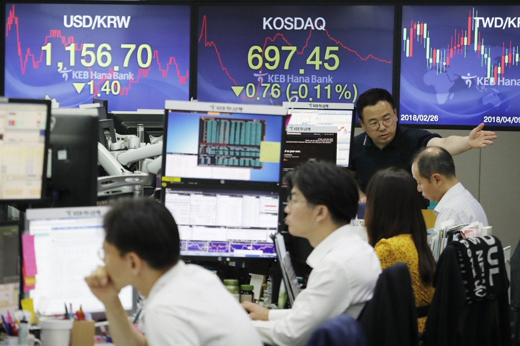 A currency trader gestures at the foreign exchange dealing room of the KEB Hana Bank headquarters in Seoul, South Korea, Friday, June 28, 2019. Asian ...