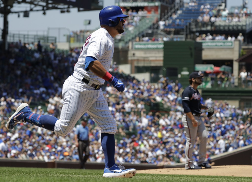 Chicago Cubs' Kyle Schwarber rounds the bases after hitting a solo home run during the first inning of a baseball game against the Atlanta Braves in C...