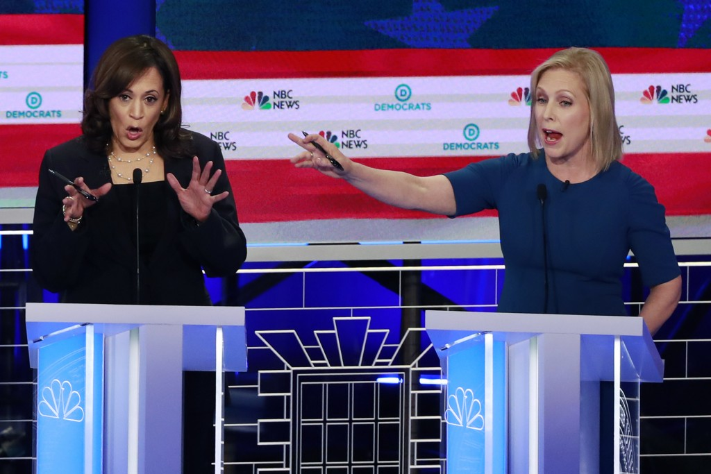 Democratic presidential candidate Sen. Kristen Gillibrand, D-N.Y., right, interrupts Sen. Kamala Harris, D-Calif., during the Democratic primary debat...