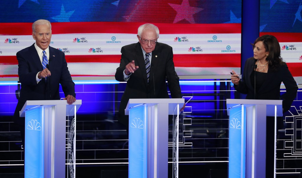 Democratic presidential candidate former vice president Joe Biden, left, Sen. Bernie Sanders, I-Vt., and Sen. Kamala Harris, D-Calif., all talk at the...