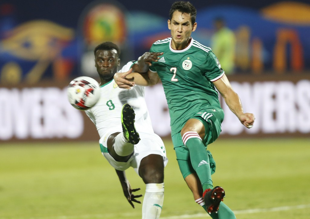 Senegal's Cheikhou Kouyate clears the ball in front of \a;2\ during the African Cup of Nations group C soccer match between Algeria and Senegal at 30 ...