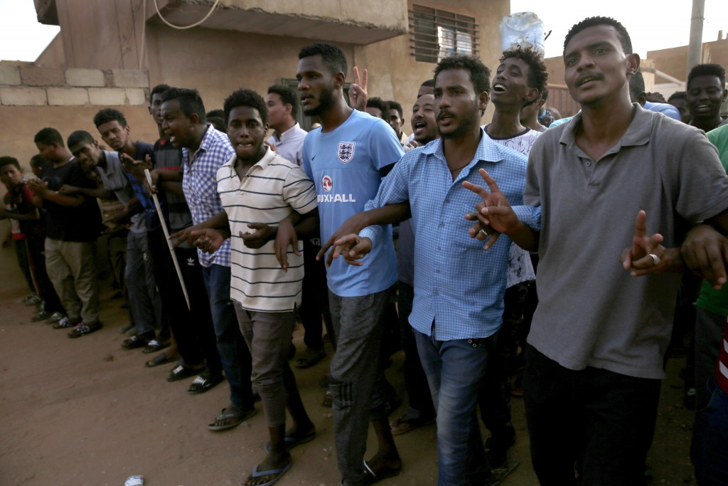 Sudanese protesters shout slogans, as they march during a protest against the military council, in Khartoum, Sudan, Thursday, June 27, 2019. The U.S. ...