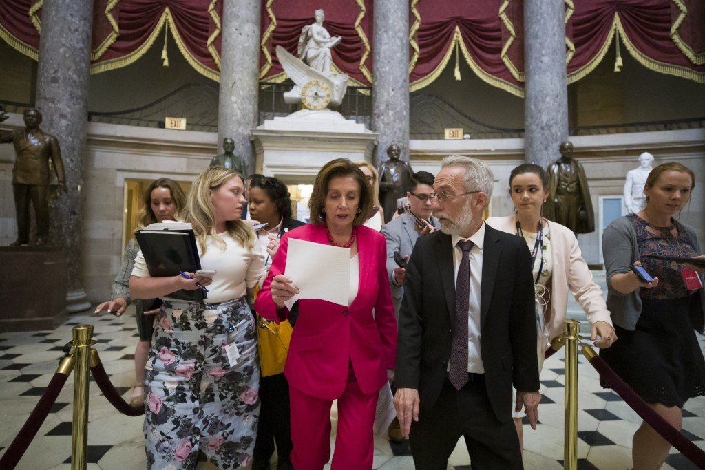 House Speaker Nancy Pelosi of Calif., walks to the House floor from her office on Capitol Hill, Thursday, June 27, 2019 in Washington. (AP Photo/Alex ...
