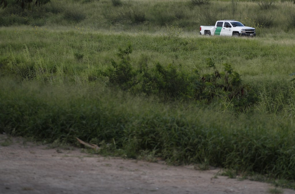 FILE - In this June 27, 2019, file photo, a U.S. Border Patrol car drives along the Rio Grande in Brownsville, Texas, as seen from Matamoros, Tamaulip...