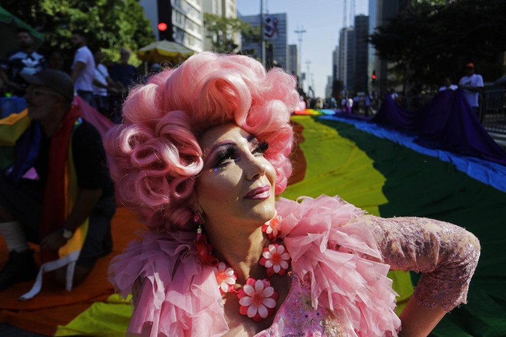 A reveler poses for a picture during the annual gay pride parade along Paulista avenue in Sao Paulo, Brazil, Sunday, June 23, 2019. (AP Photo/Nelson A...