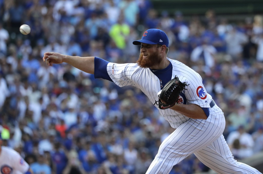 Chicago Cubs closer Craig Kimbrel throws to an Atlanta Braves batter during the ninth inning of a baseball game in Chicago, Thursday, June 27, 2019. T...