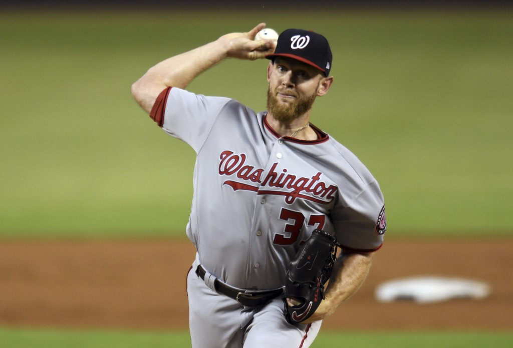 Washington Nationals' Stephen Strasburg pitches to a Miami Marlins batter during the first inning of a baseball game Thursday, June 27, 2019, in Miami...