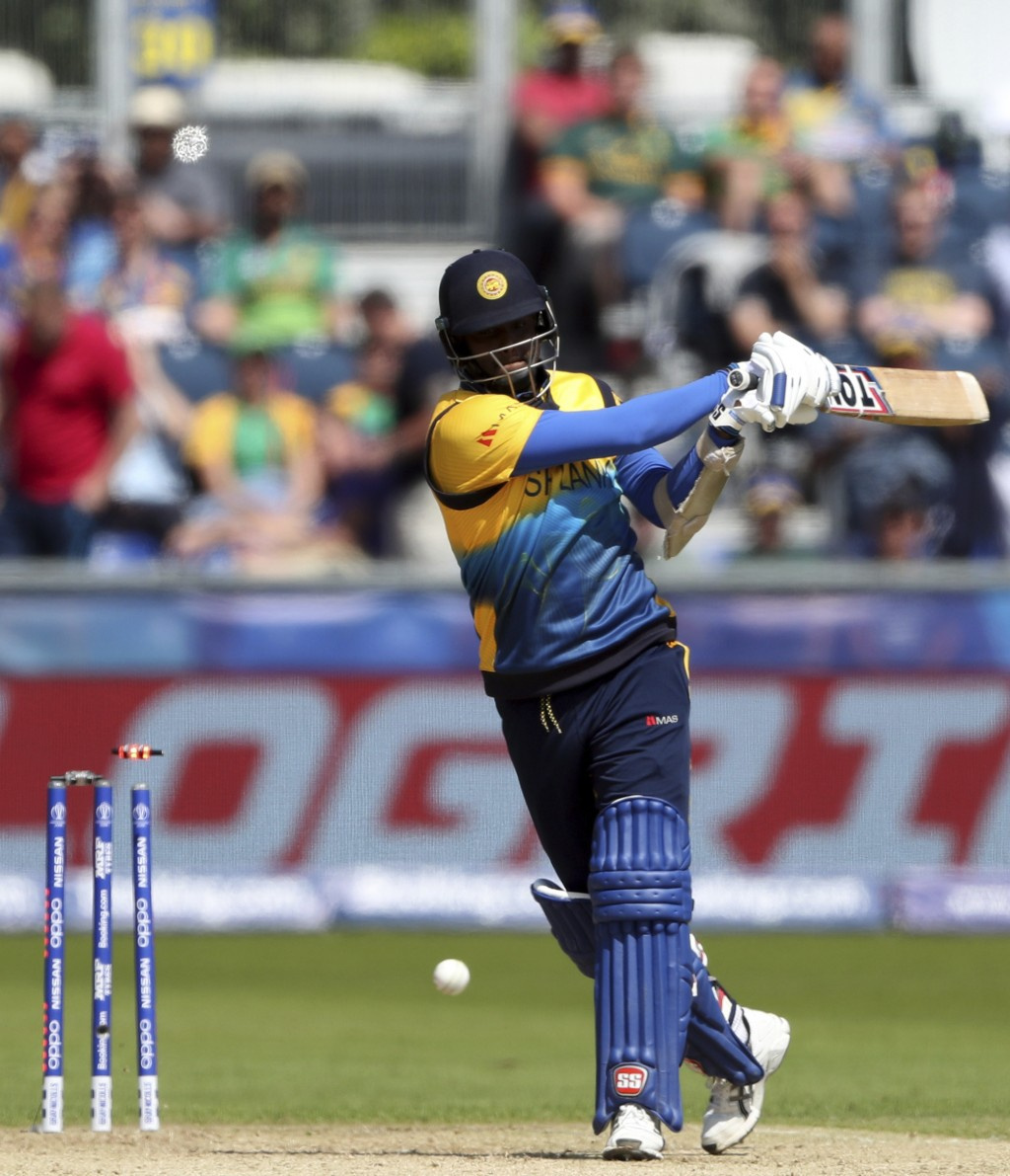 Sri Lanka's batsman Angelo Mathews is bowled by South Africa's bowler Chris Morris during the Cricket World Cup match between Sri Lanka and South Afri...