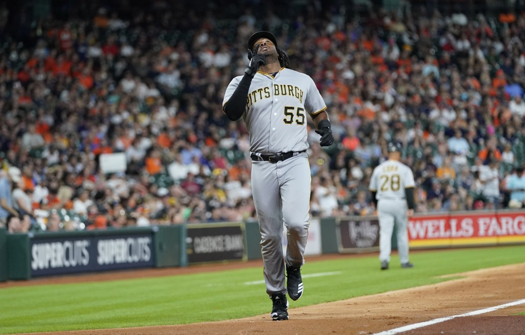 Pittsburgh Pirates' Josh Bell (55) celebrates after hitting a two-run home run against the Houston Astros during the third inning of a baseball game T...