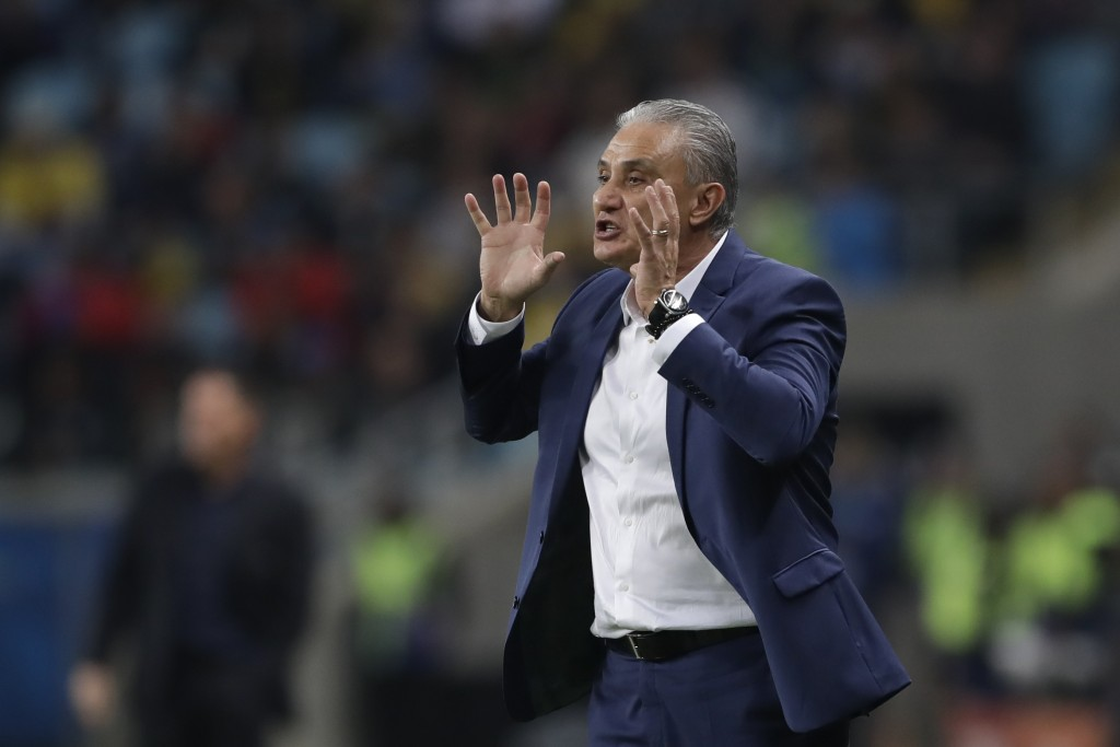 Brazil's coach Tite gives instructions from the sideline during a Copa America quarterfinal soccer match against Paraguay at the Arena do Gremio in Po...