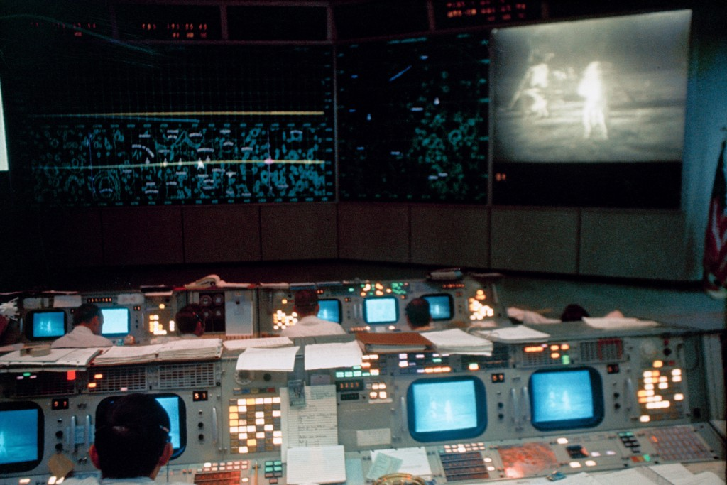 This July 20, 1969 photo made available by NASA shows the Mission Operations Control Room (MOCR) in the Mission Control Center (MCC), Building 30, dur...