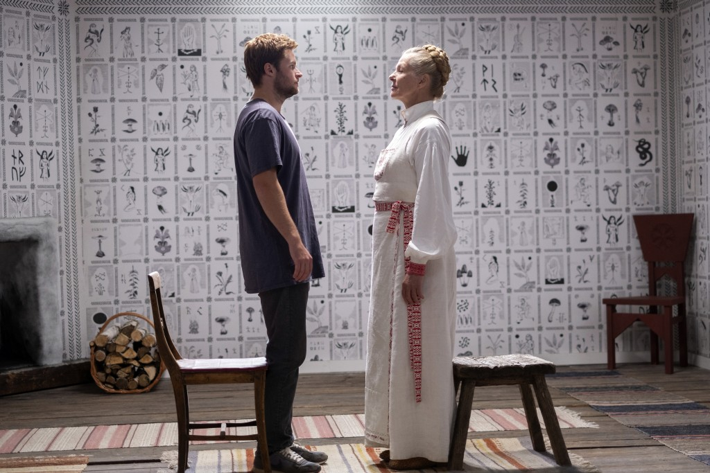 """This image released by A24 shows Jack Reynor, left, and Gunnel Fred in a scene from the horror film """"Midsommar."""" (Gabor Kotschy/A24 via AP)"""