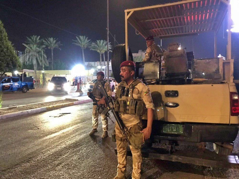 Iraqi security forces stand guard near Bahraini embassy in Baghdad, Iraq, Thursday, June 27, 2019. Protesters stormed the Bahraini embassy compound in...